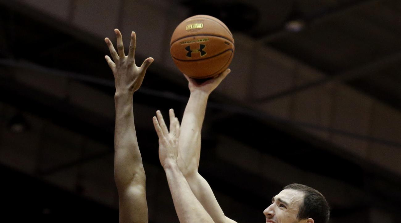 Illinois center Maverick Morgan, right, shoots over Northwestern center Derek Pardon during the first half of an NCAA college basketball game on Saturday, Feb. 13, 2016, in Evanston, Ill. (AP Photo/Nam Y. Huh)
