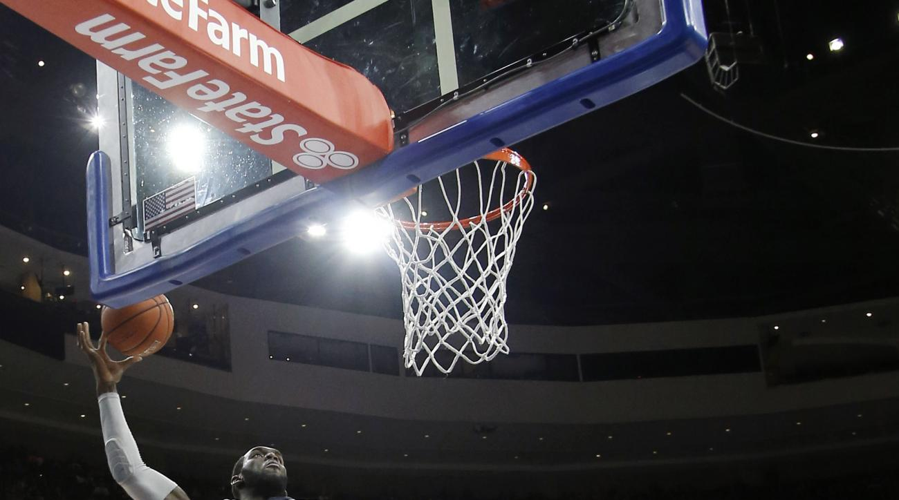 Villanova's Daniel Ochefu, left, goes up for a dunk against St. John's Ron Mvouika during the first half of an NCAA college basketball game, Saturday, Feb. 13, 2016, in Philadelphia. (AP Photo/Matt Slocum)