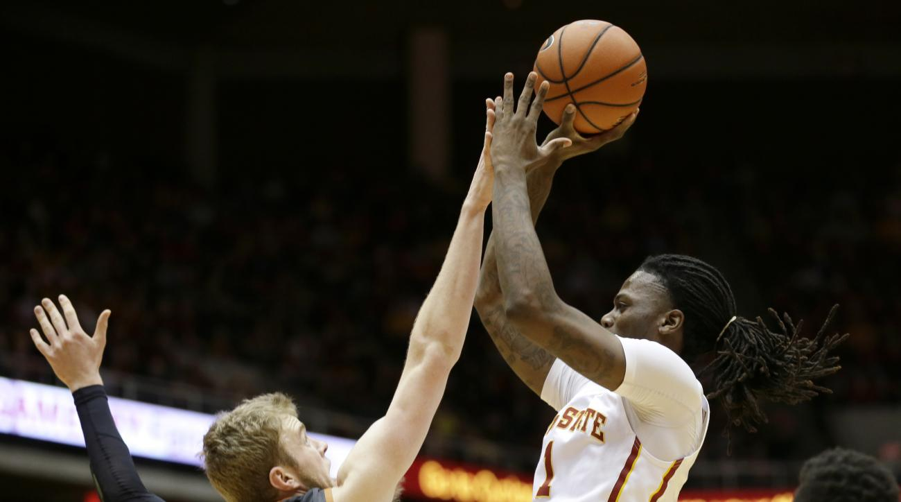 Iowa State forward Jameel McKay shoots over Texas forward Connor Lammert, left, during the first half of an NCAA college basketball game Saturday, Feb. 13, 2016, in Ames, Iowa. (AP Photo/Charlie Neibergall)