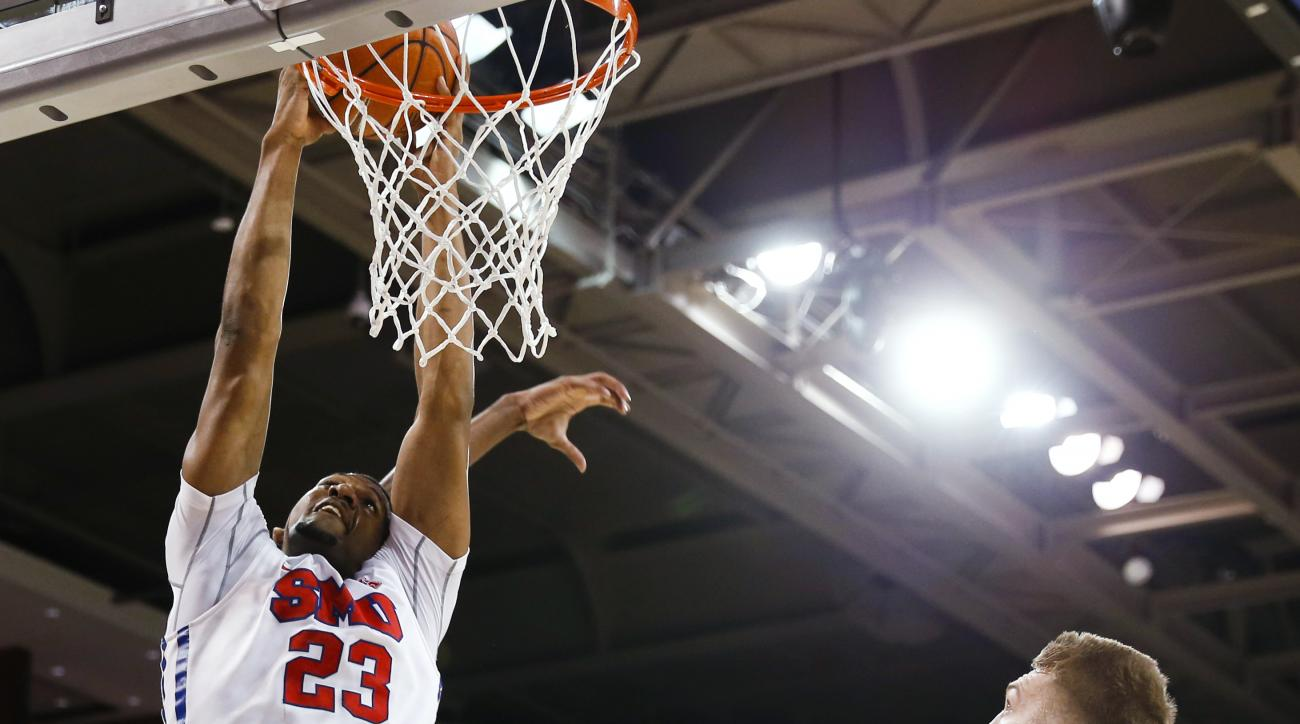 SMU forward Jordan Tolbert (23) dunks in front of Gonzaga forward Domantas Sabonis (11) during the first half of an NCAA college basketball game Saturday, Feb. 13, 2016, in Dallas. (AP Photo/Jim Cowsert)