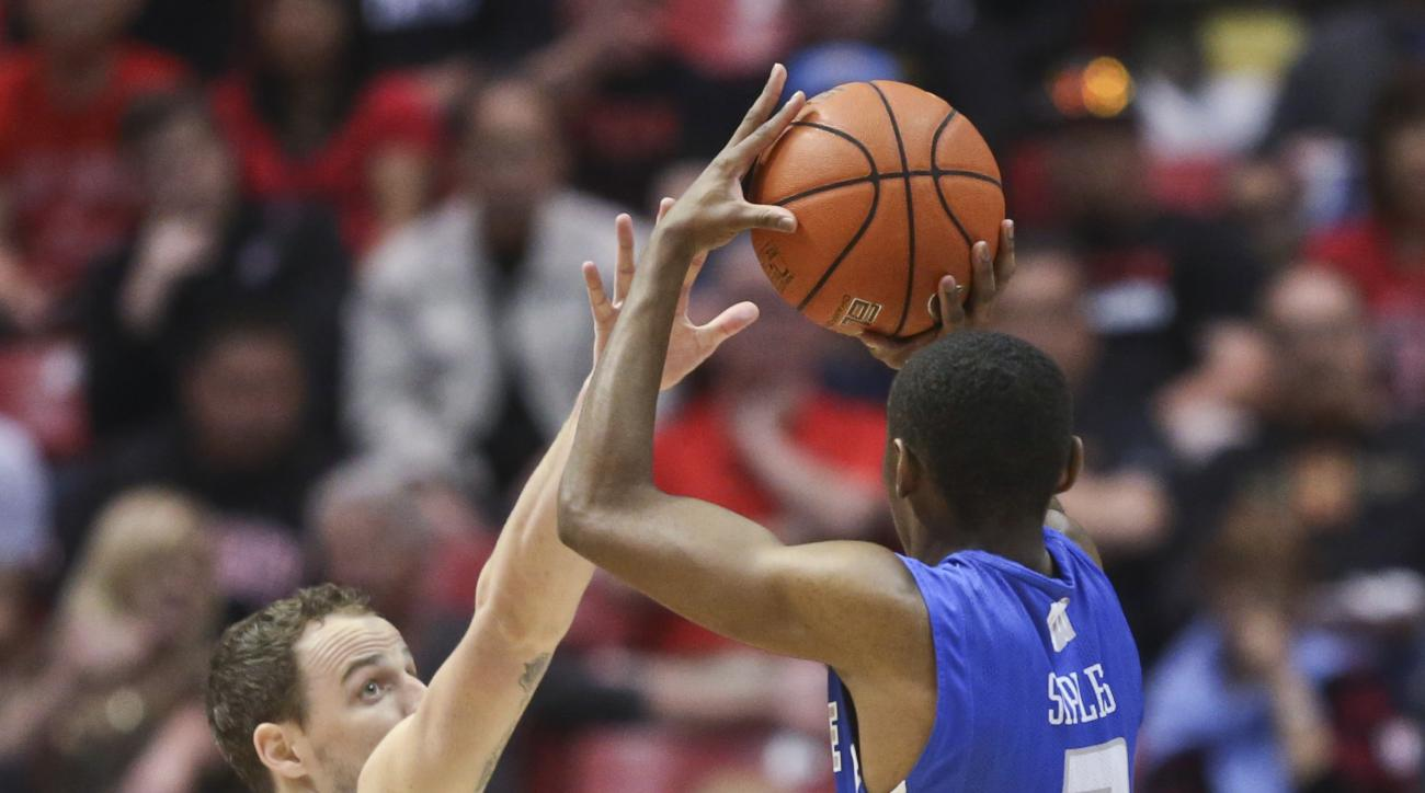 Air Force guard CJ Siples shoots over San Diego State forward Matt Shrigley during the first half of an NCAA college basketball game Saturday, Feb. 13, 2016, in San Diego. (AP Photo/Lenny Ignelzi)
