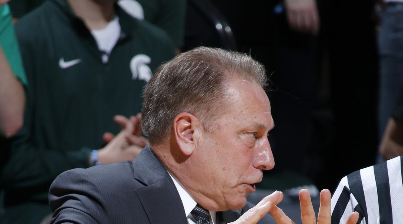 Michigan State coach Tom Izzo discusses a call during the first half of an NCAA college basketball game against Indiana, Sunday, Feb. 14, 2016, in East Lansing, Mich. Michigan State won 88-69. (AP Photo/Al Goldis)