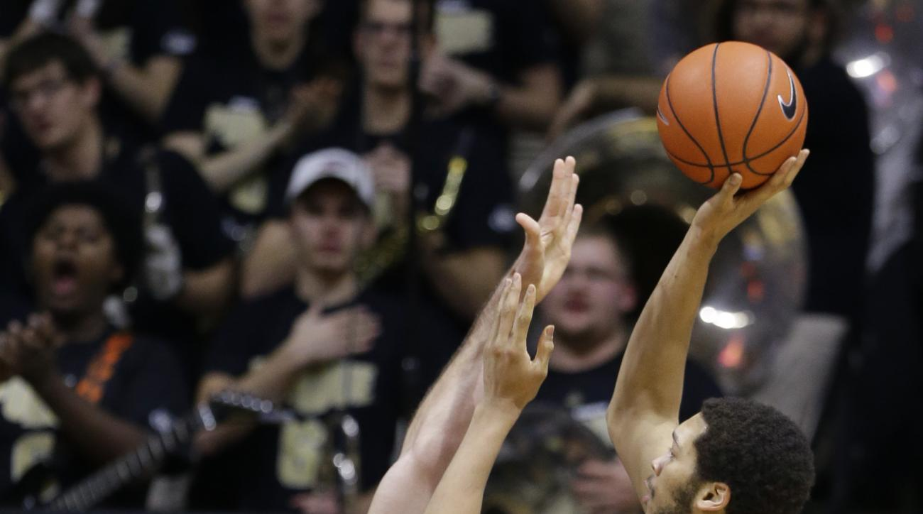Purdue center A.J. Hammons (20) shoots over Northwestern center Alex Olah (22)in the first half of an NCAA college basketball game in West Lafayette, Ind., Tuesday, Feb. 16, 2016. (AP Photo/Michael Conroy)