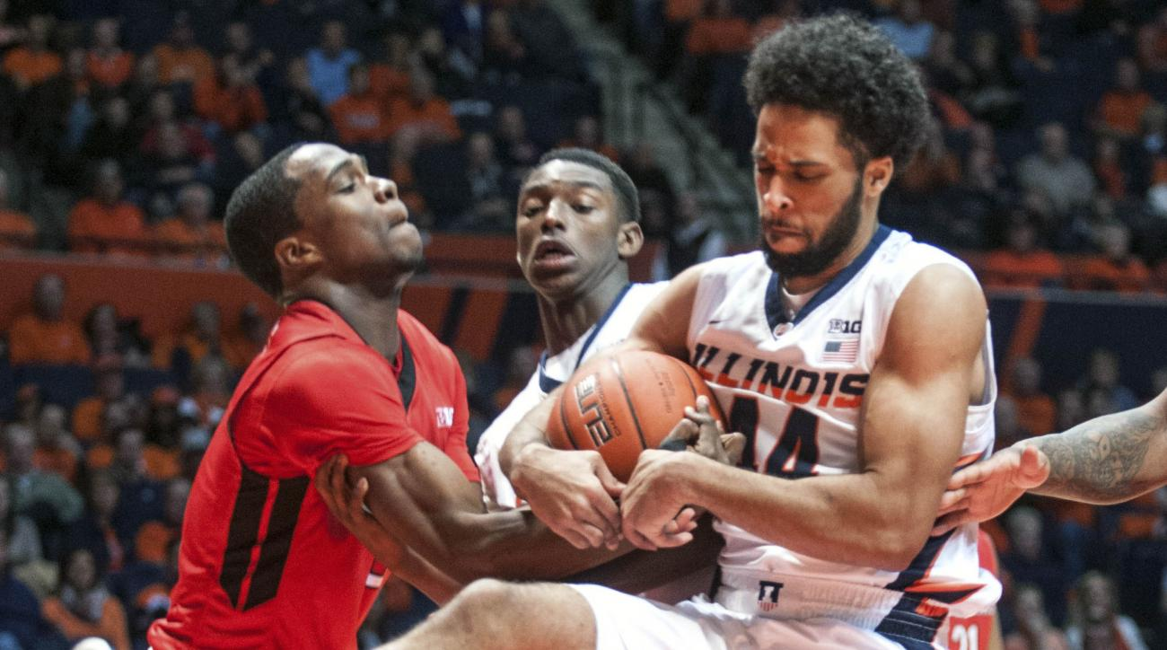 Illinois' guard Alex Austin (44) and Rutgers' guard Mike Williams (5) struggle over the ball as Illinois' guard Jalen Coleman-Lands (5) looks on in the second half of the NCAA college basketball game at State Farm Center in Champaign, Ill on Tuesday, Feb.