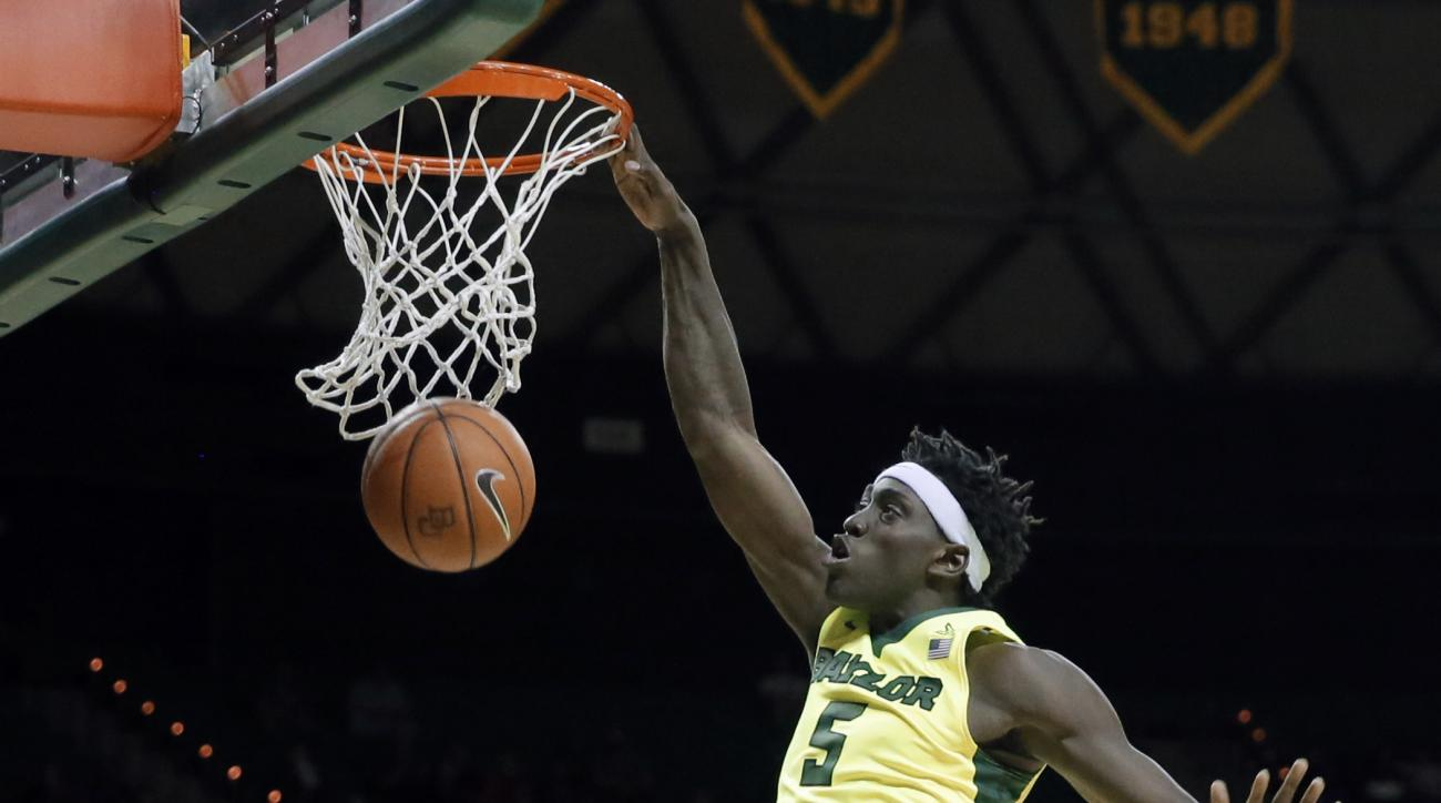 Baylor forward Johnathan Motley (5) dunks the ball over Iowa State's Deonte Burton (30) as Monte Morris (11) watches in the second half of an NCAA college basketball game, Tuesday, Feb. 16, 2016, in Waco, Texas. Baylor won in overtime, 100-91. (AP Photo/T