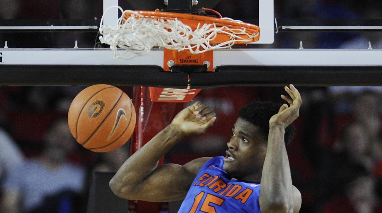 Florida center John Egbunu dunks during the second half of an NCAA college basketball game against Georgia on Tuesday, Feb. 16, 2016, in Athens, Ga. Florida won 57-53. (AJ Reynolds/Athens Banner-Herald via AP)