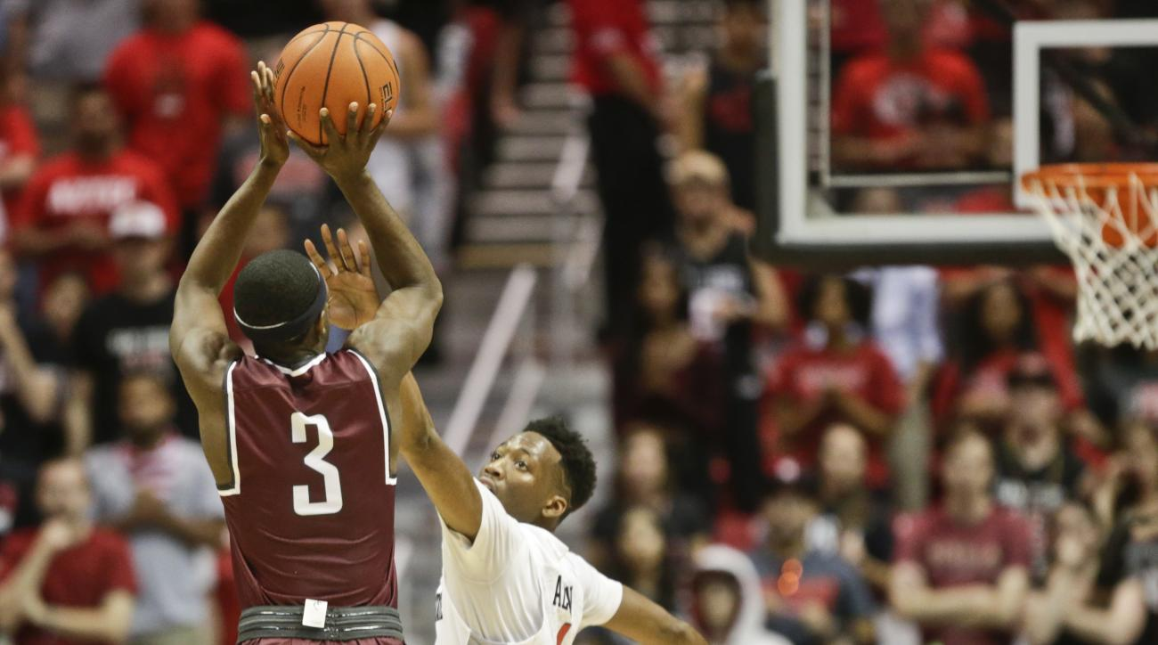 FIL - In this Nov. 21, 2015, file photo, Arkansas-Little Rock guard Josh Hagins (3) shooits a three-point basket over San Diego State guard Dakarai Allen in the second half of an NCAA college basketball game in San Diego. Expectations were low this season