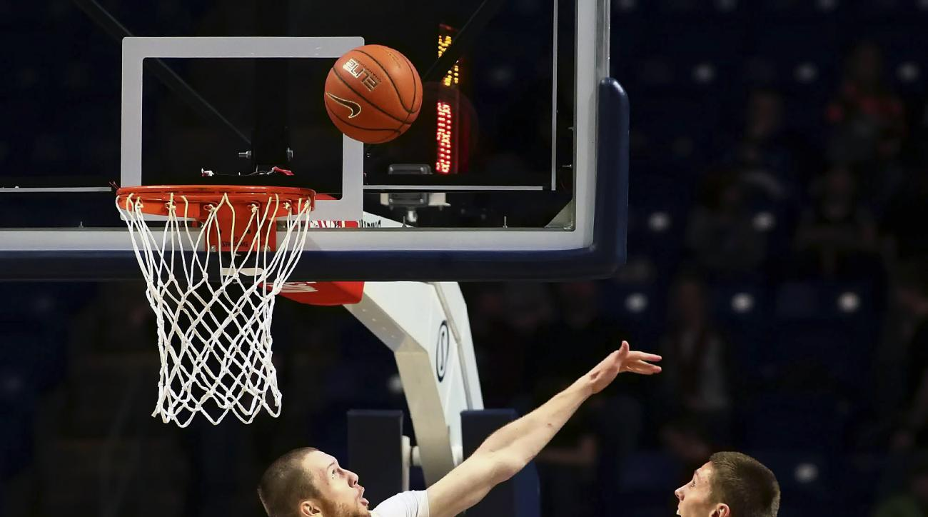 Penn State forward Donovan Jack (5) blocks a shot by Iowa forward Jarrod Uthoff (20) during the first half of an NCAA college basketball game, Wednesday, Feb. 17, 2016, in State College, Pa. (AP Photo/Chris Knight)
