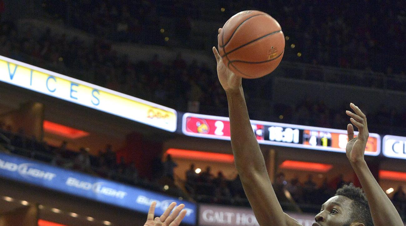 Syracuse's Malachi Richardson (23) attempts a off balance shot past the defense of Louisville's Chinanu Onuaku (32) during the first half of an NCAA college basketball game, Monday, Feb. 17,  2016, in Louisville Ky. (AP Photo/Timothy D. Easley)