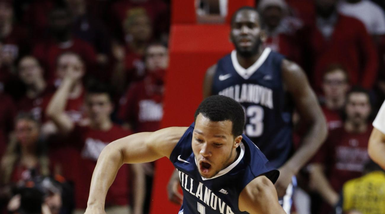 Villanova's Jalen Brunson, top, and Temple's Josh Brown collide while chasing the ball during the second half of an NCAA college basketball game Wednesday, Feb. 17, 2016, in Philadelphia. Villanova won 83-67. (AP Photo/Matt Slocum)
