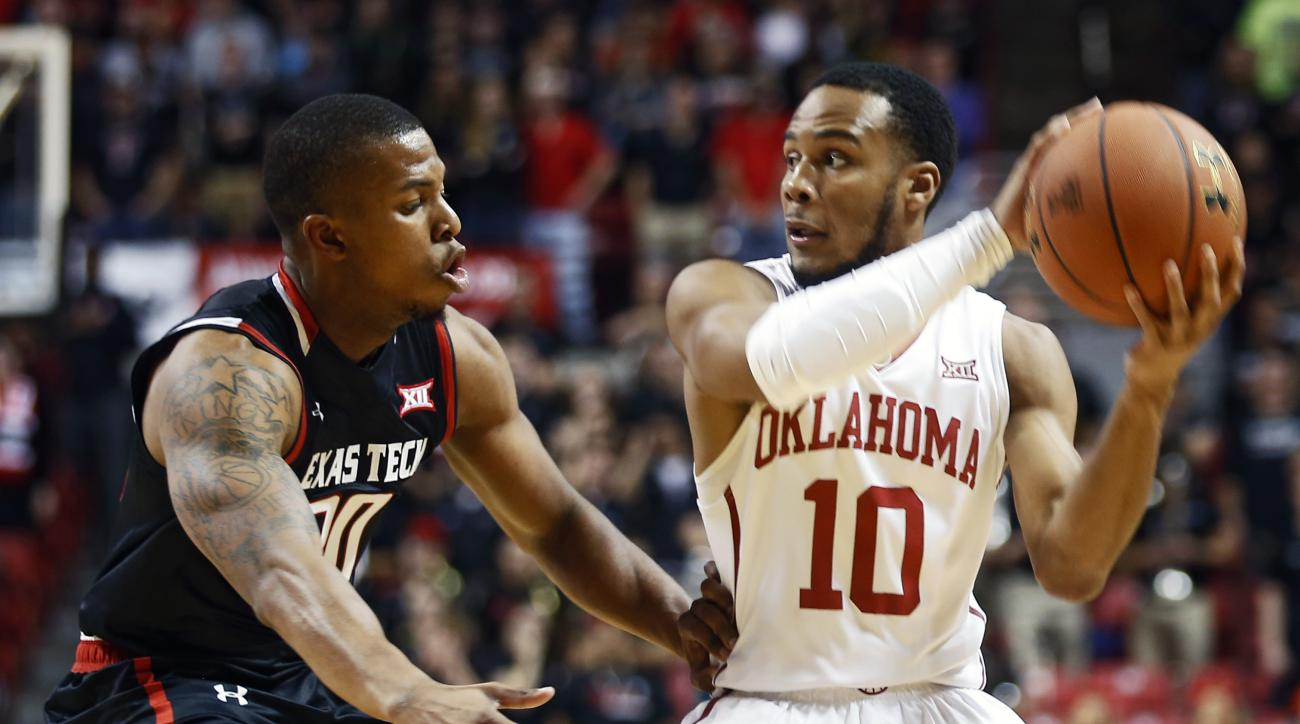 Texas Tech's Toddrick Gotcher, left, defends Oklahoma's Jordan Woodard (10) during the first half of an NCAA college basketball game on Wednesday, Feb. 17, 2016 in Lubbock, Texas. (AP Photo/Brad Tollefson)