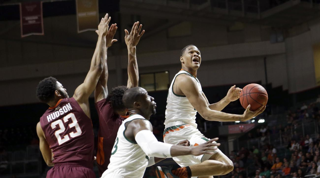 Miami guard James Palmer (12) goes to the basket against Virginia Tech during the first half of an NCAA college basketball game,  Wednesday, Feb. 17, 2016, in Coral Gables, Fla. (AP Photo/Alan Diaz)