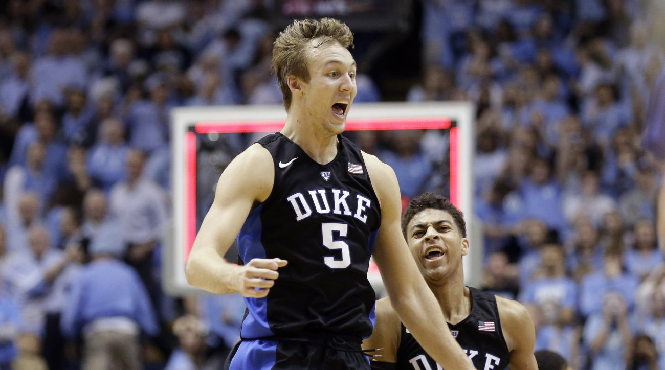 Duke's Luke Kennard (5) and Derryck Thornton (12) celebrate the team's 74-73 victory over North Carolina in an NCAA college basketball game in Chapel Hill, N.C., Wednesday, Feb. 17, 2016. (AP Photo/Gerry Broome)