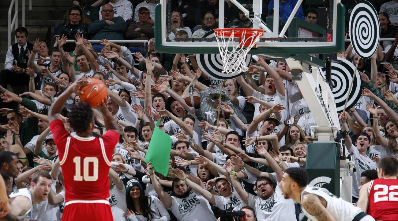 Michigan State fans try to distract Wisconsin's Nigel Hayes (10) as he shoots a free throw during the first half of an NCAA college basketball game Thursday, Feb. 18, 2016, in East Lansing, Mich. (AP Photo/Al Goldis)