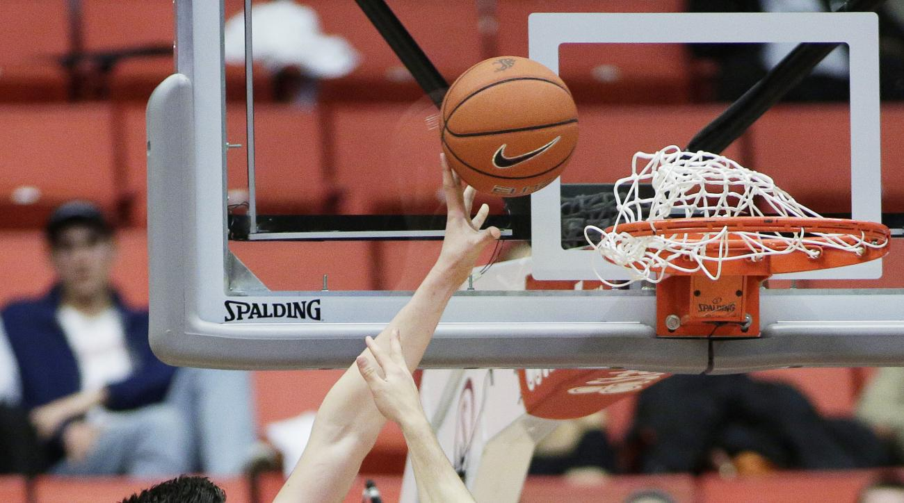 Washington State's Conor Clifford, left, shoots against Stanford's Rosco Allen (25) during the second half of an NCAA college basketball game Thursday, Feb. 18, 2016, in Pullman, Wash. Stanford won 72-56. (AP Photo/Young Kwak)