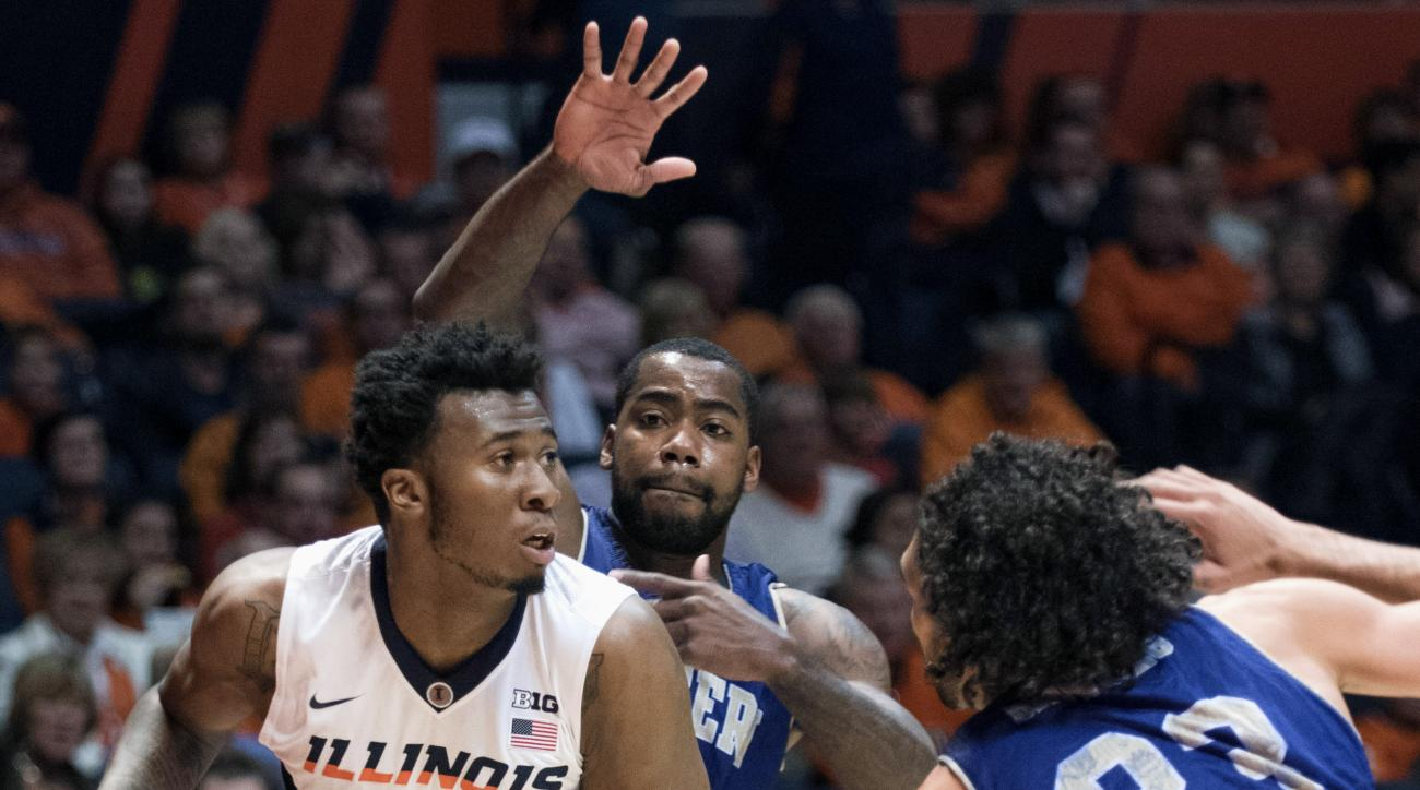 FILE - In this Dec. 5, 2015 file photo, Illinois' Leron Black (12) looks to pass during an NCAA college basketball game against Western Carolina in Champaign, Ill.  Authorities say Black was arrested early Friday, Feb. 19, 2016, in Champaign and has been