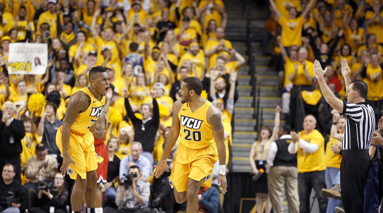 VCU's Melvin Johnson (32) and Jordan Burgess (20) celebrate a Burgess 3-point basket in the second half of an NCAA college basketball game against Richmond in Richmond, Va., Friday, Feb. 19, 2016. (Mark Gormus/Richmond Times-Dispatch via AP) MANDATORY CRE