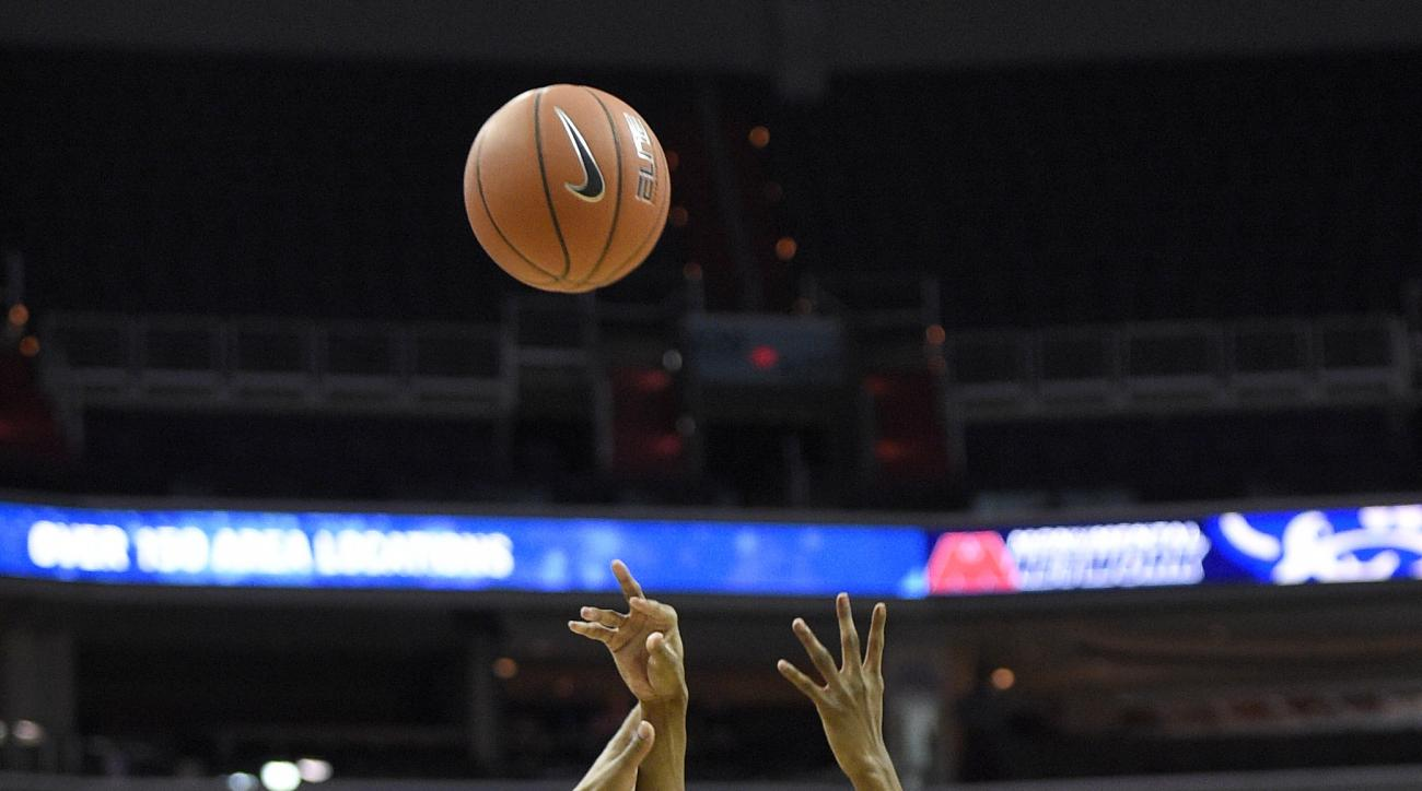 Xavier guard Edmond Sumner (4) takes a shot over Georgetown center Jessie Govan (15) during the first half of an NCAA college basketball game, Saturday, Feb. 20, 2016, in Washington. (AP Photo/Nick Wass)