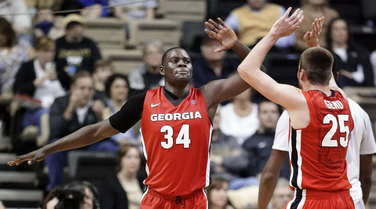 Georgia forward Derek Ogbeide (34) celebrates with Kenny Paul Geno (25) after a play against Vanderbilt in the first half of an NCAA college basketball game Saturday, Feb. 20, 2016, in Nashville, Tenn. (AP Photo/Mark Humphrey)
