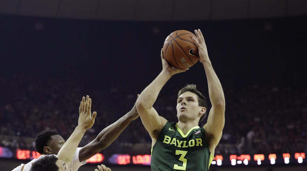 Baylor guard Jake Lindsey, right, shoots over Texas guard Javan Felix, left, during the first half of an NCAA college basketball game, Saturday, Feb. 20, 2016, in Austin, Texas. (AP Photo/Eric Gay)