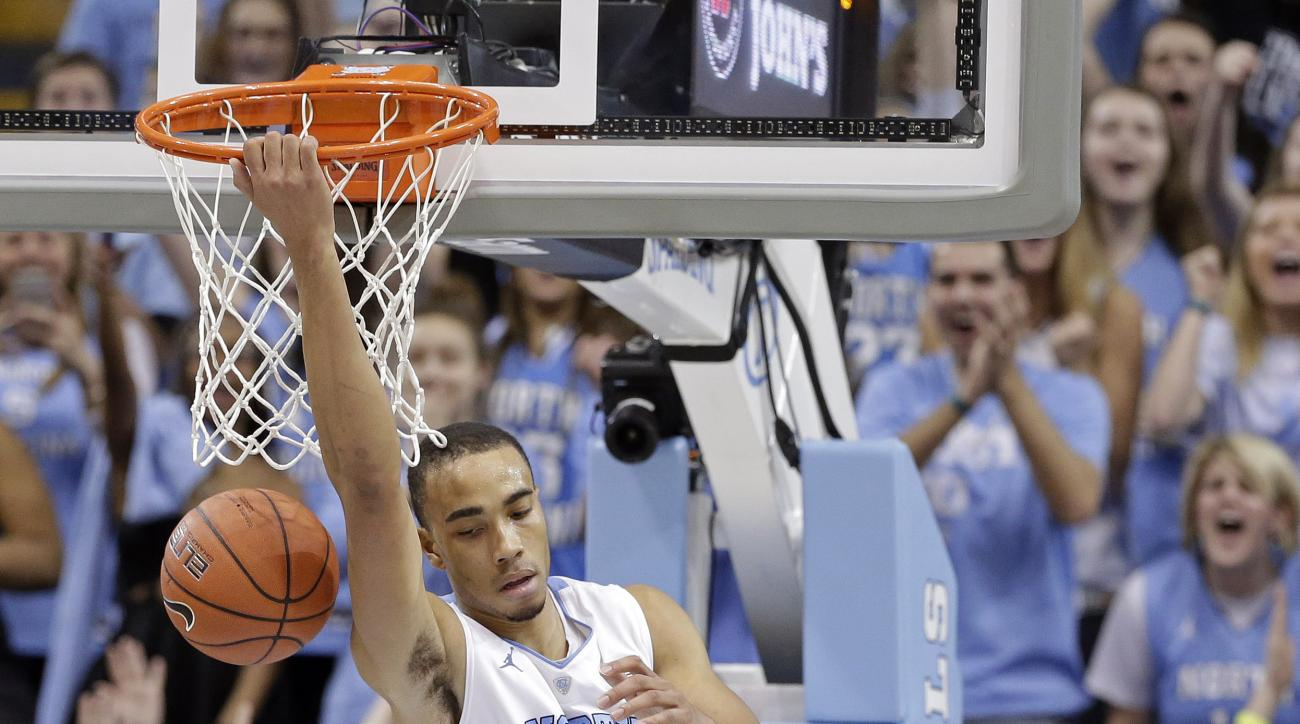 North Carolina's Brice Johnson (11) dunks against Miami during the second half of an NCAA college basketball game in Chapel Hill, N.C., Saturday, Feb. 20, 2016. North Carolina won 96-71. (AP Photo/Gerry Broome)