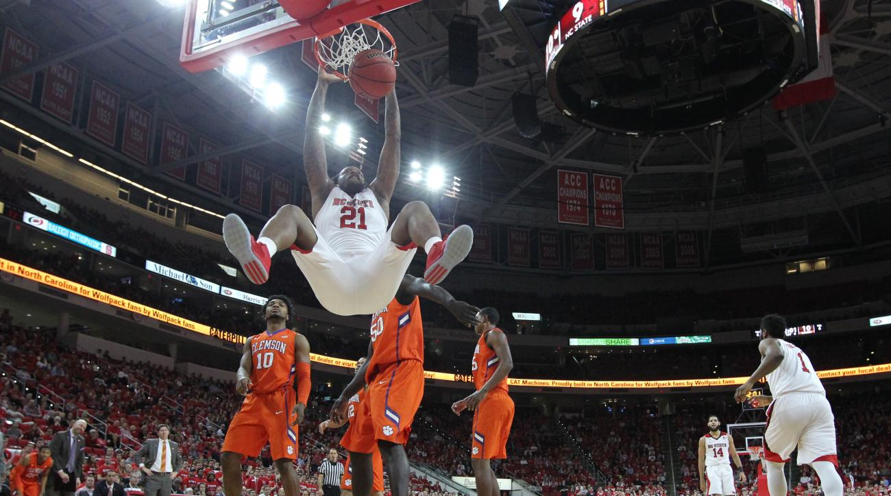 North Carolina State's BeeJay Anya (21) dunks against Clemson during the first half of an NCAA college basketball game at PNC Arena in Raleigh, N.C., Saturday, Feb. 20, 2016. (Ethan Hyman/The News & Observer via AP) MANDATORY CREDIT