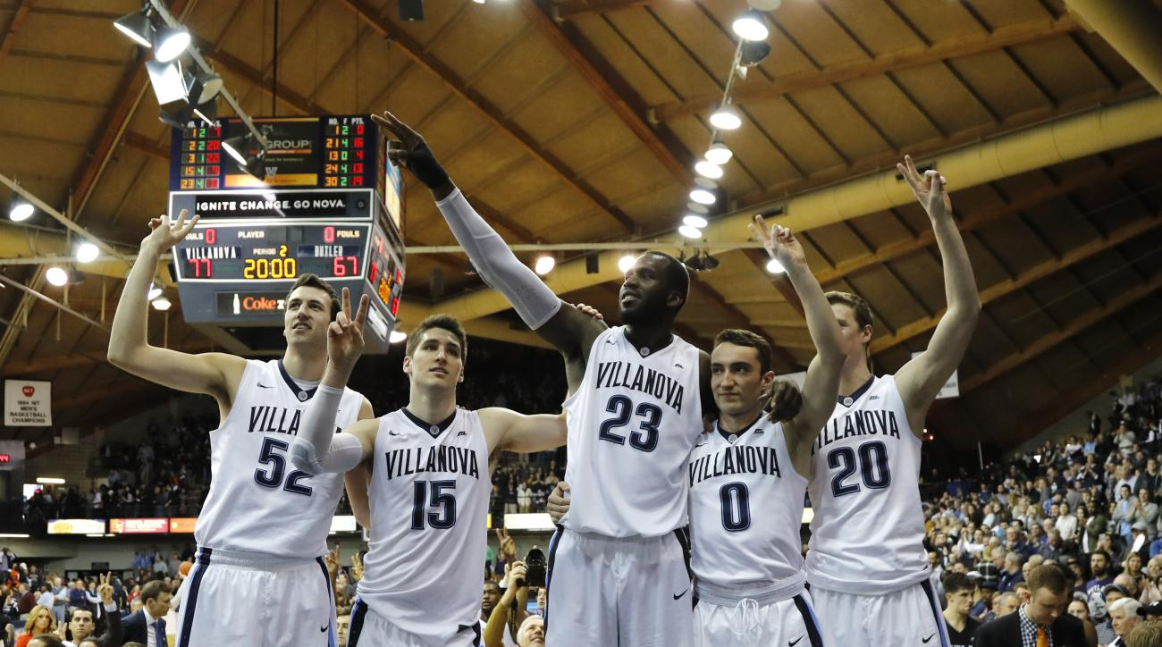 Villanova's Kevin Rafferty, from left, Ryan Arcidiacono, Daniel Ochefu, Henry Lowe, and Patrick Farrell celebrate after their 77-67 win over Butler in an NCAA college basketball game, Saturday, Feb. 20, 2016, in Villanova, Pa. (AP Photo/Matt Slocum)