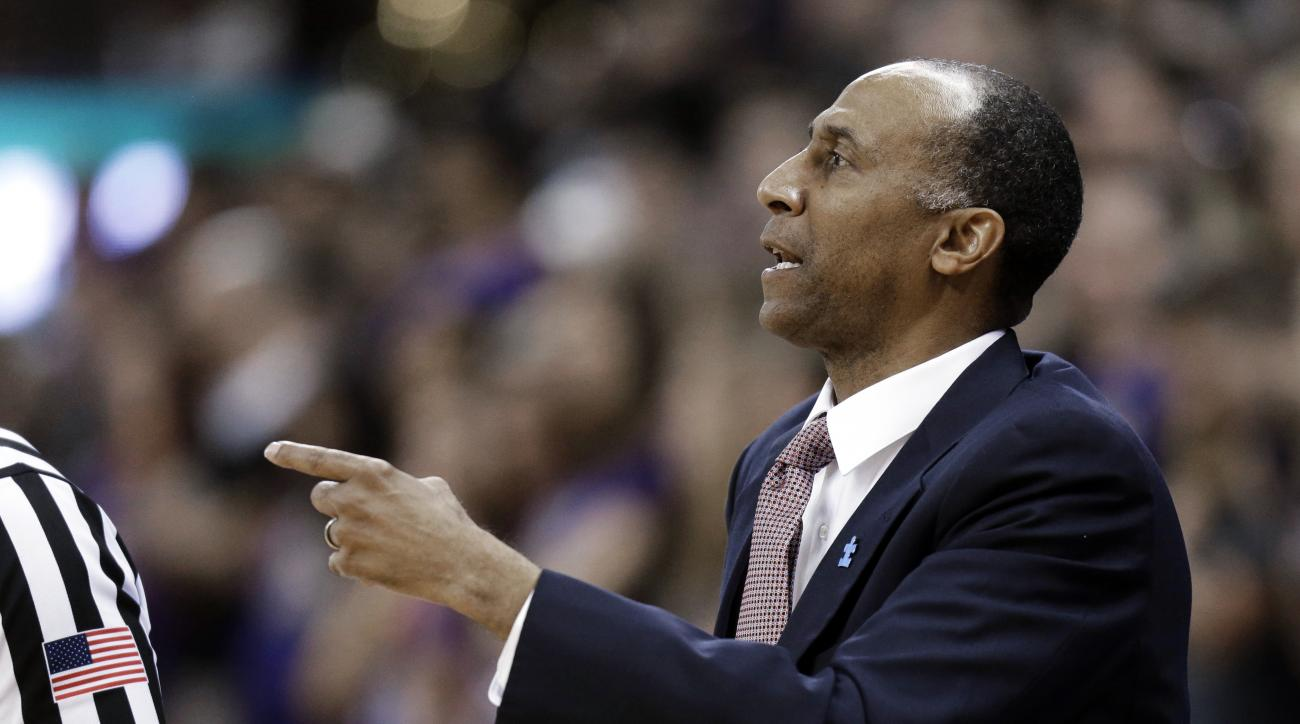 Stanford coach Johnny Dawkins gestures from the sideline during the first half of the team's NCAA college basketball game against Washington, Saturday, Feb. 20, 2016, in Seattle. (AP Photo/Ted S. Warren)