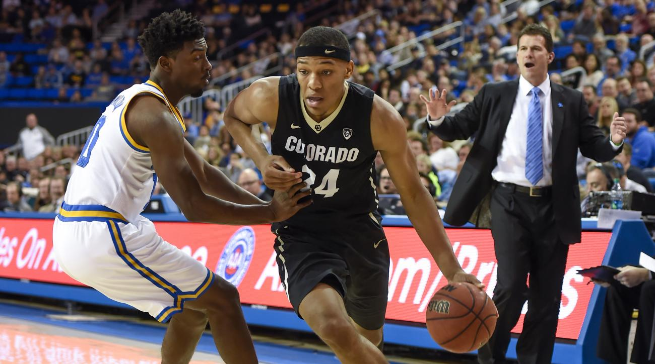 Colorado guard George King (24) gets by UCLA guard Isaac Hamilton as he drives to the basket as UCLA coach Steve Alford, back right, watches during the first half of an NCAA college basketball game Saturday, Feb. 20, 2016, in Los Angeles. (AP Photo/Gus Ru