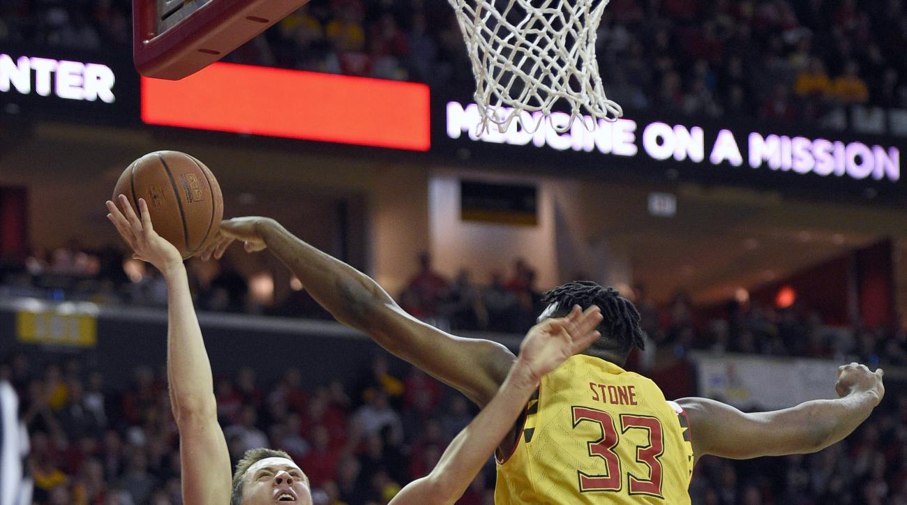 Michigan guard Duncan Robinson (22) Maryland center Diamond Stone (33) during the first half of an NCAA college basketball game Sunday, Feb. 21, 2016, in College Park, Md. (AP Photo/Nick Wass)