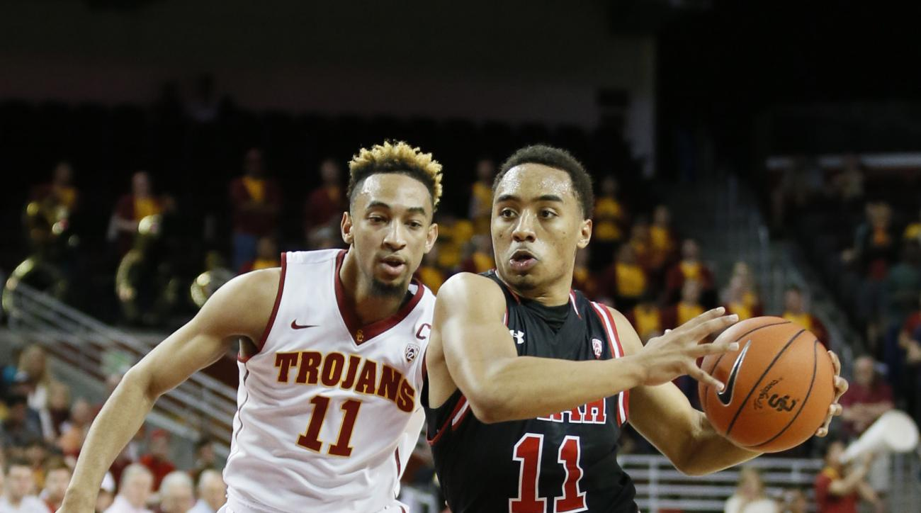 Utah's Brandon Taylor, right, drives past Southern California's Jordan McLaughlin, left, during the first half of an NCAA college basketball game, Sunday, Feb. 21, 2016, in Los Angeles. (AP Photo/Danny Moloshok)