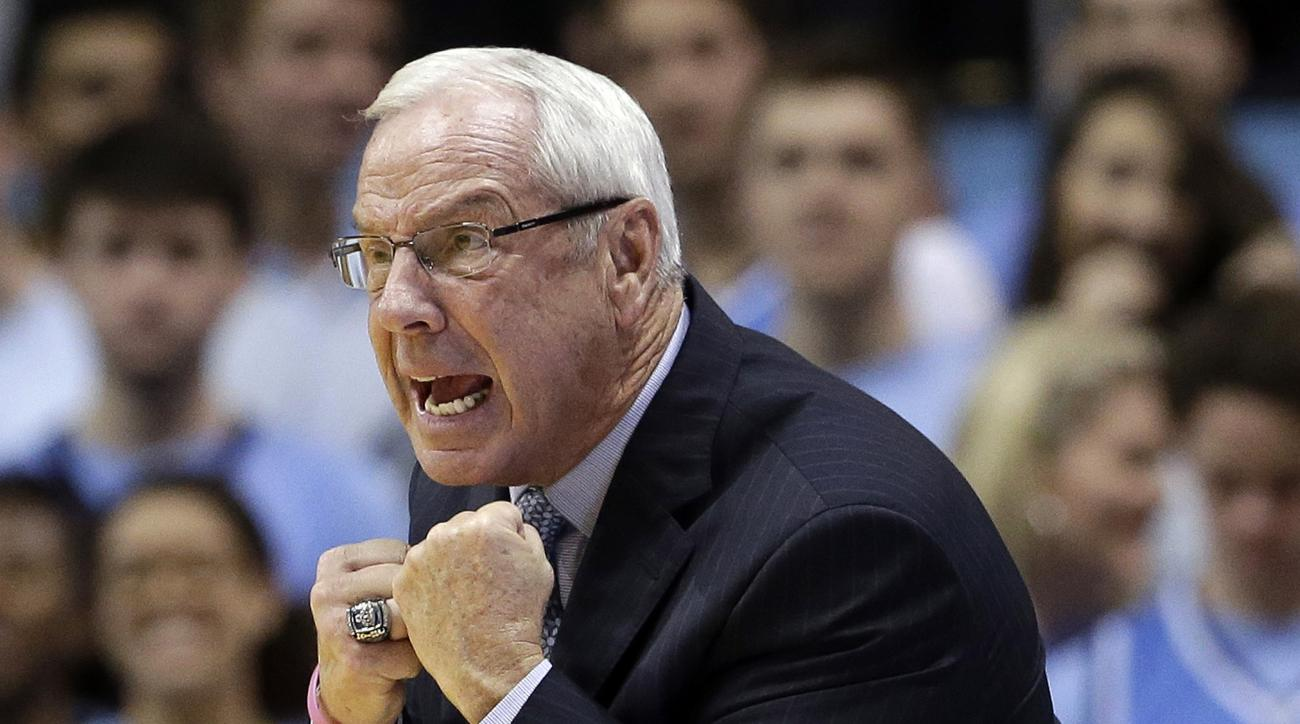 FILE - In this Nov. 18, 2015, file photo, North Carolina coach Roy Williams reacts during the second half of an NCAA college basketball game against Wofford in Chapel Hill, N.C. The preseason No. 1 team scores, takes care of the basketball (third in assis