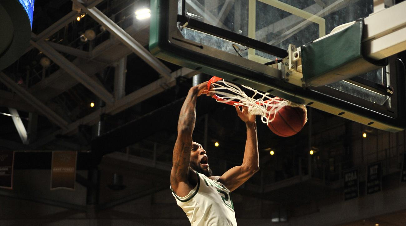 Miami forward Kamari Murphy, top, dunk against Virginia's Jarred Reuter during the first half action of an NCAA college basketball game in Coral Gables, Fla., Monday, Feb. 22, 2016. (AP Photo/Gaston De Cardenas)