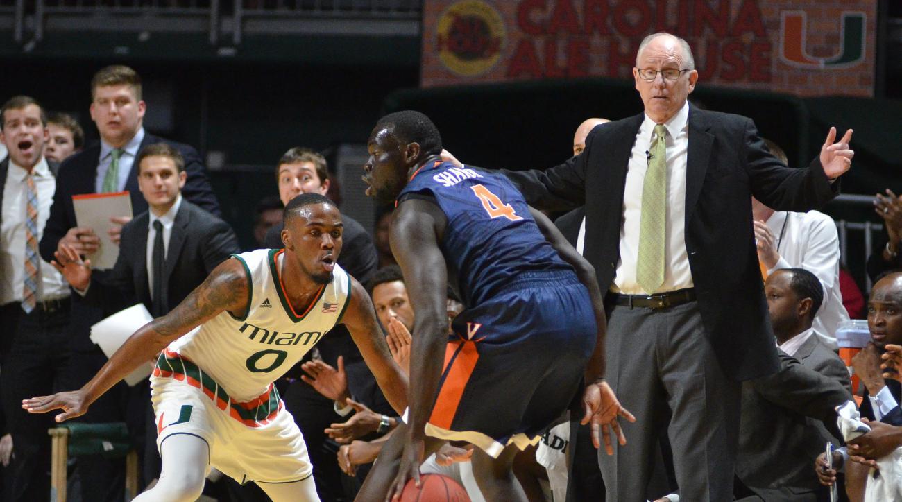 Miami's Ja'Quan Newton defends against Virginia's Marial Shayok during an NCAA college basketball game in Coral Gables, Fla., Monday, Feb. 22, 2016. (AP Photo/Gaston De Cardenas)