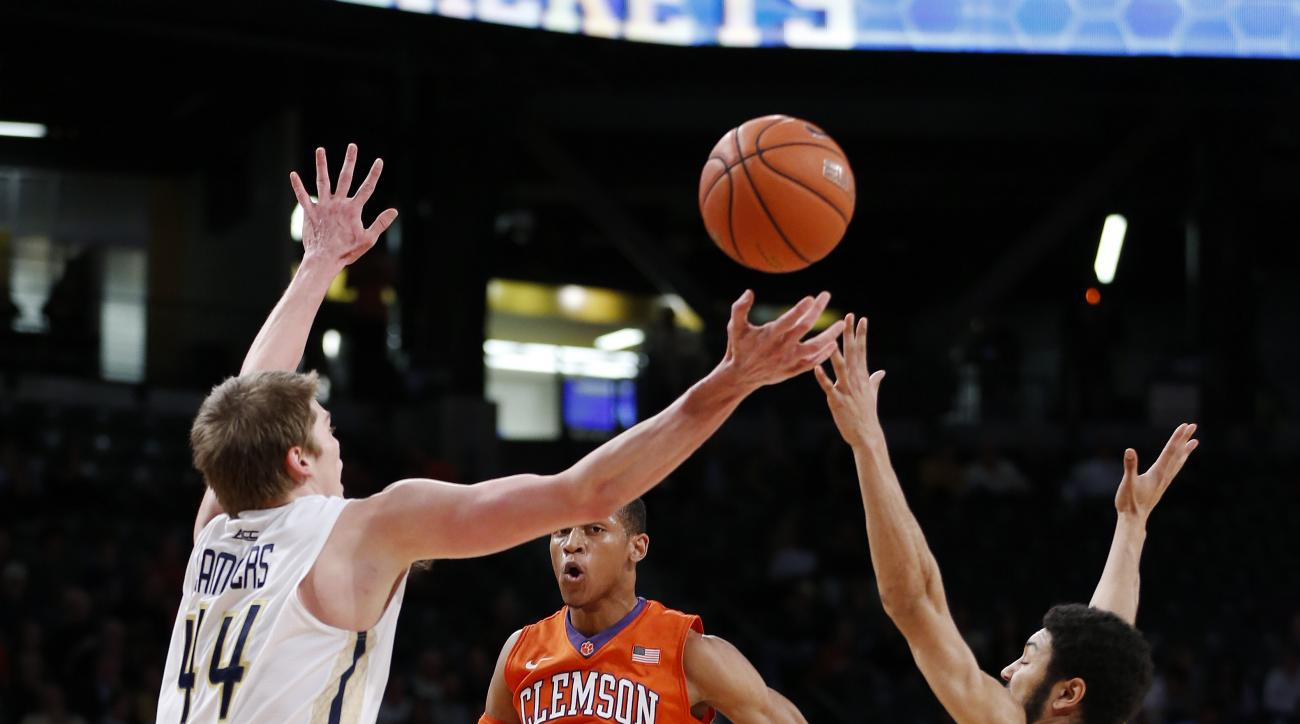 Clemson guard Jordan Roper (20) passes over Georgia Tech defenders Georgia Tech center Ben Lammers (44) and  guard Josh Heath during the first half of an NCAA college basketball game Tuesday, Feb. 23, 2016, in Atlanta.  (AP Photo/John Bazemore)