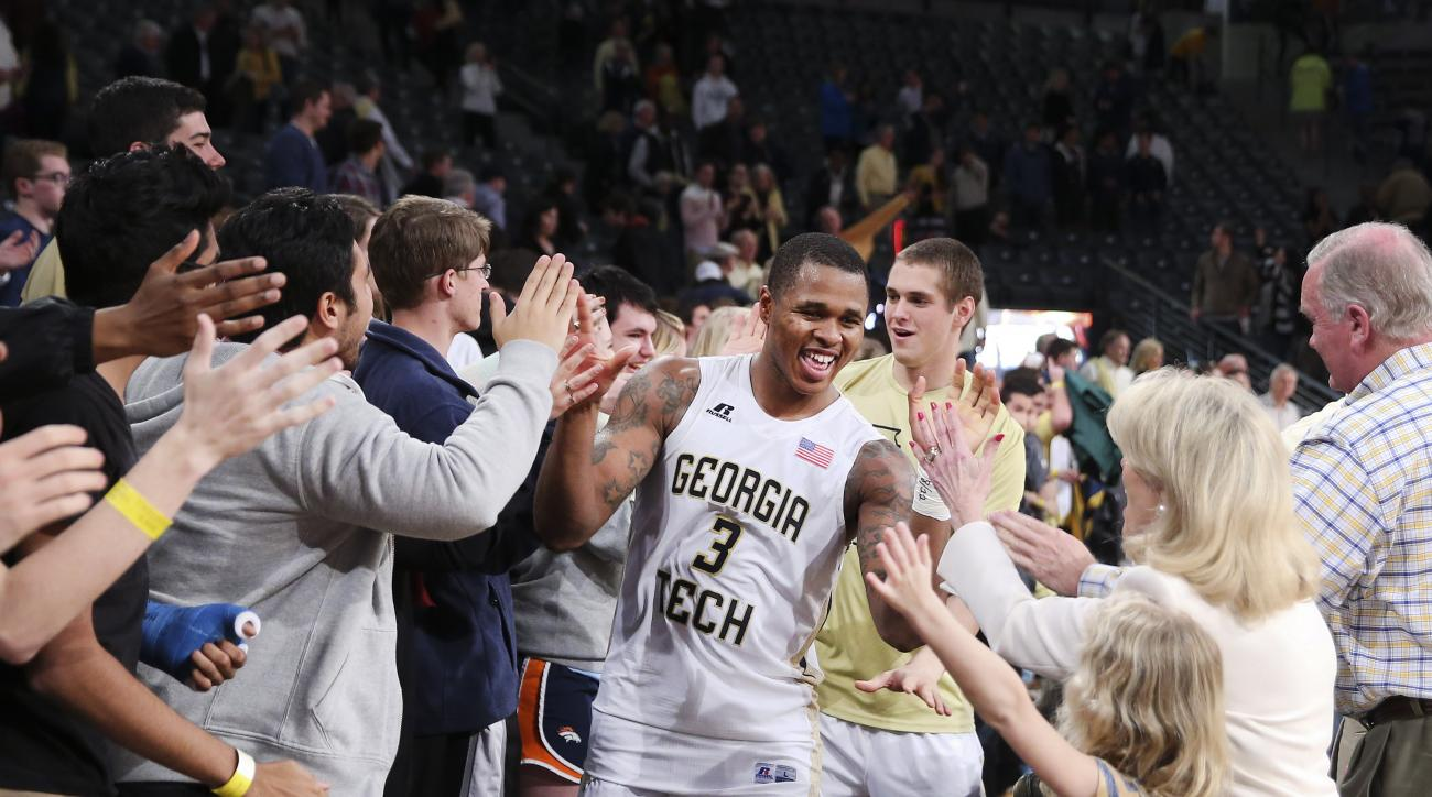 Georgia Tech guard Marcus Georges-Hunt (3) celebrates with fans after Georgia defeated Clemson 75-73 in an NCAA college basketball game Tuesday, Feb. 23, 2016, in Atlanta. (AP Photo/John Bazemore)