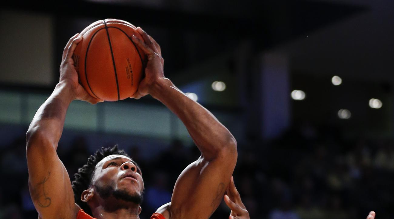 Clemson forward Jaron Blossomgame (5) goes up for a shot against Georgia Tech forward Charles Mitchell (0) during the first half of an NCAA college basketball game Tuesday, Feb. 23, 2016, in Atlanta.  (AP Photo/John Bazemore)