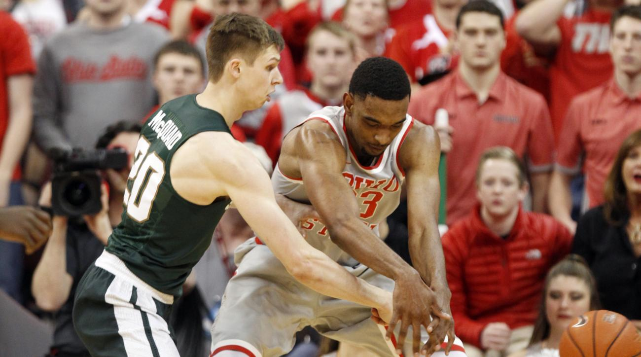Michigan State's Matt Mcquaid, left, knocks the ball away from Ohio State's Keita Bates-Diop during the first half of an NCAA college basketball game in Columbus, Ohio, Tuesday, Feb. 23, 2016. (AP Photo/Paul Vernon)
