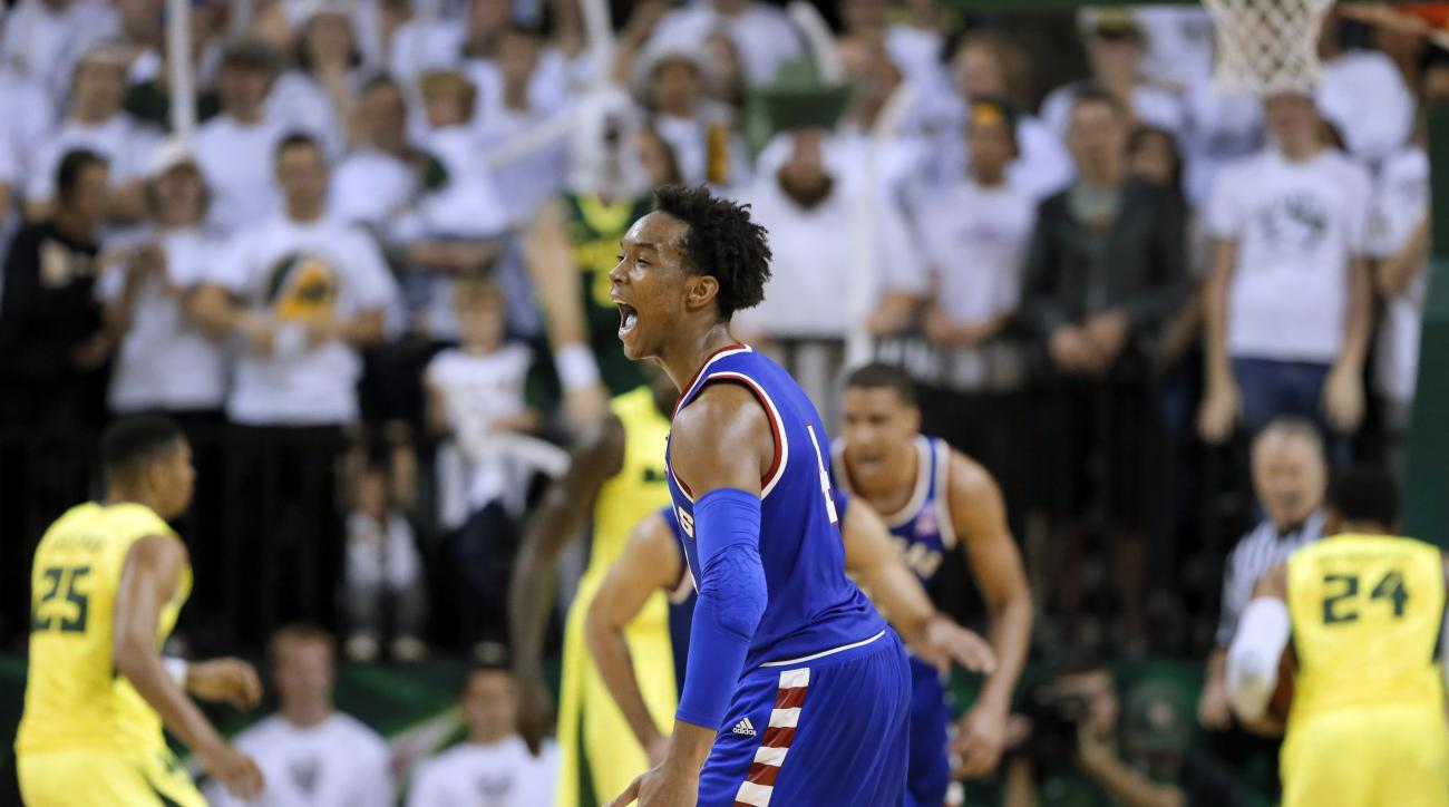 Kansas guard Devonte' Graham (4) celebrates after sinking a 3-point basket late in the second half of an NCAA college basketball game against Baylor on Tuesday, Feb. 23, 2016, in Waco, Texas. Kansas won 66-60. (AP Photo/Tony Gutierrez)