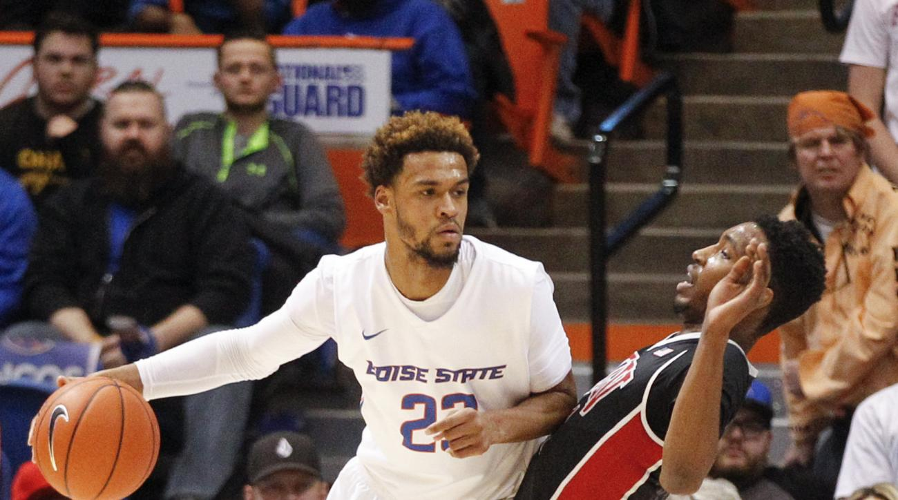 Boise State's James Webb III (23) moves the ball against UNLV's Derrick Jones Jr. (1) during the first half of an NCAA college basketball game in Boise, Idaho, on Tuesday, Feb. 23, 2016. (AP Photo/Otto Kitsinger)