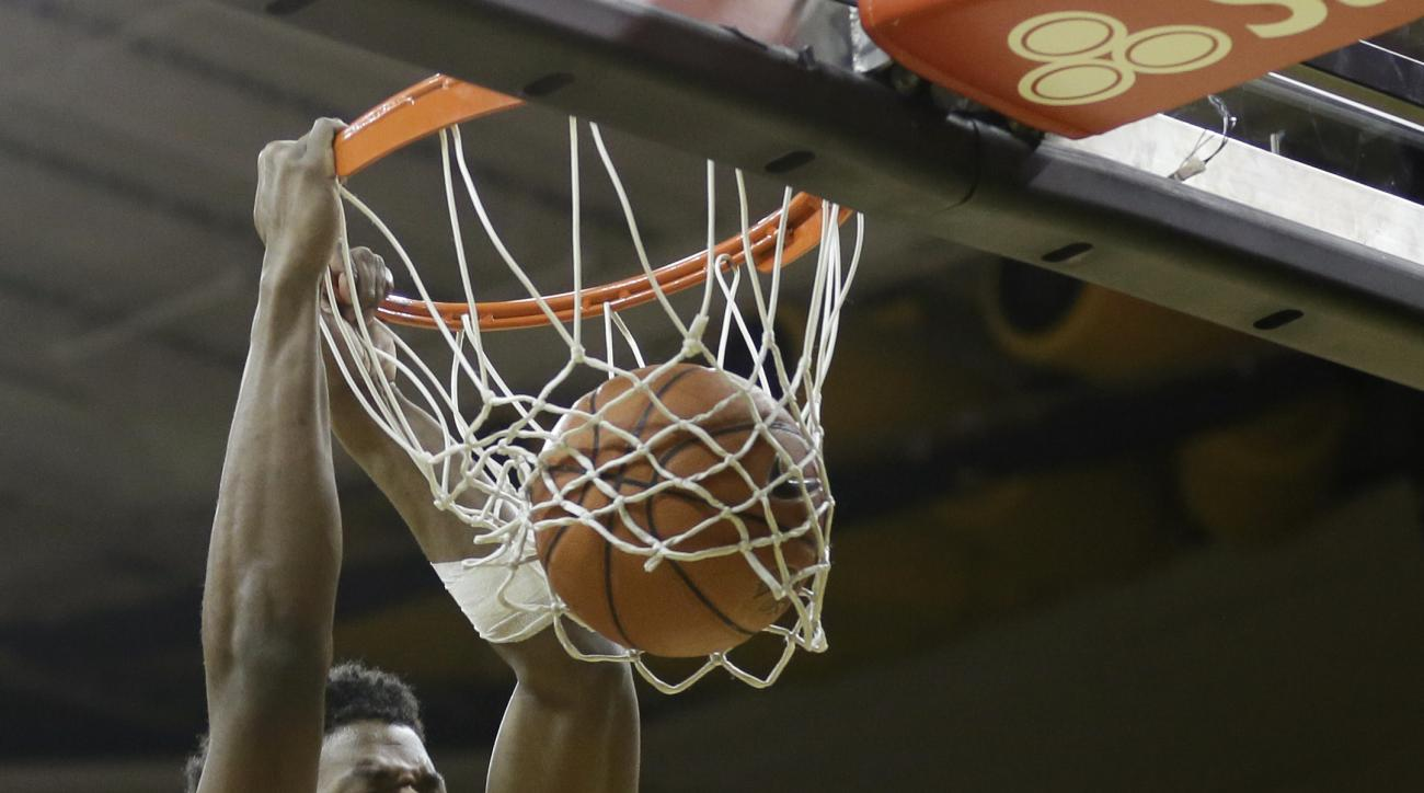 Wisconsin forward Khalil Iverson dunks the ball over Iowa guard Brady Ellingson, right, during the first half of an NCAA college basketball game, Wednesday, Feb. 24, 2016, in Iowa City, Iowa. (AP Photo/Charlie Neibergall)