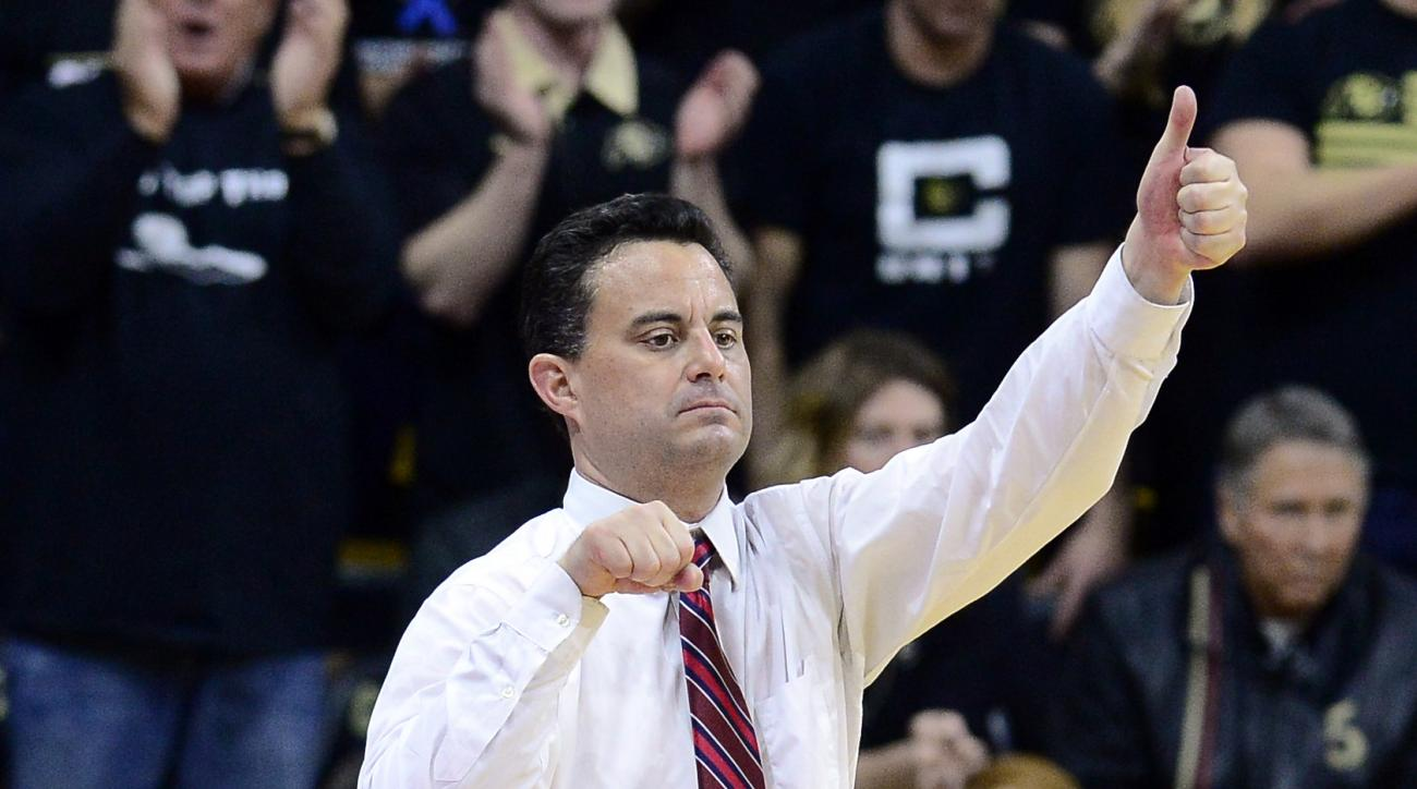 Caption: Arizona coach Sean Miller signals his players during the first half of the team's NCAA college basketball game against Arizona on Wednesday, Feb. 24, 2016, in Boulder, Coio. (AP Photo/Cliff Grassmick)