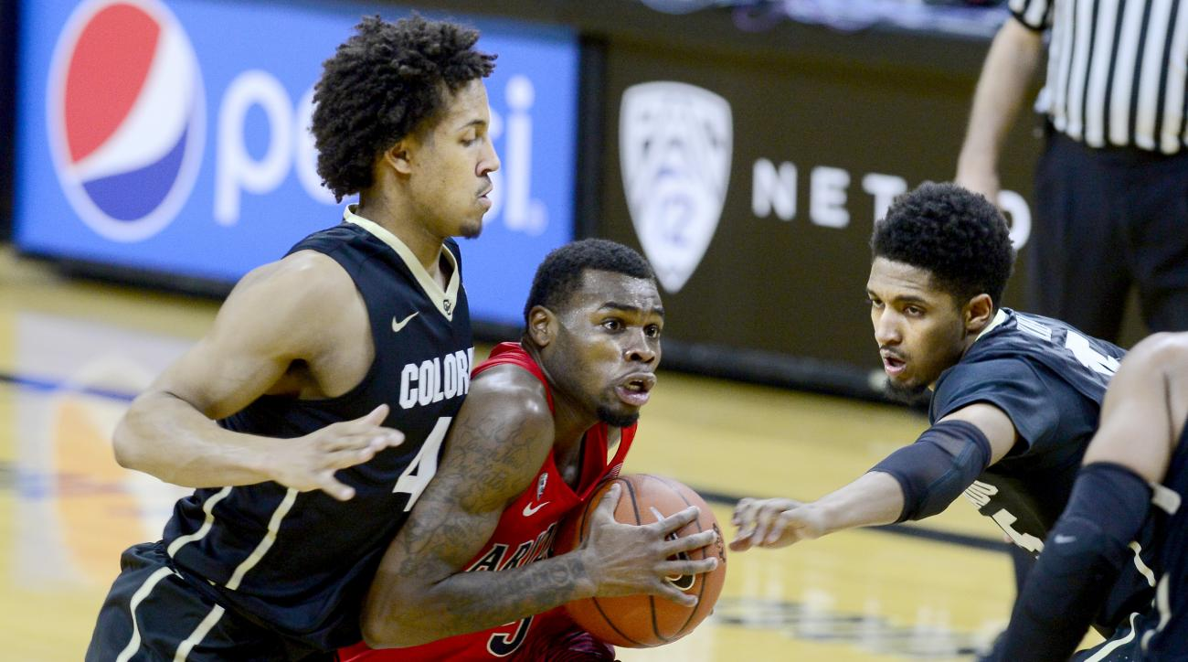 Arizona guard Kadeem Allen drives on Colorado's Josh Fortune, left, and Dominique Collier during the first half of an NCAA college basketball game Wednesday, Feb. 24, 2016, in Boulder, Coio. (AP Photo/Cliff Grassmick)