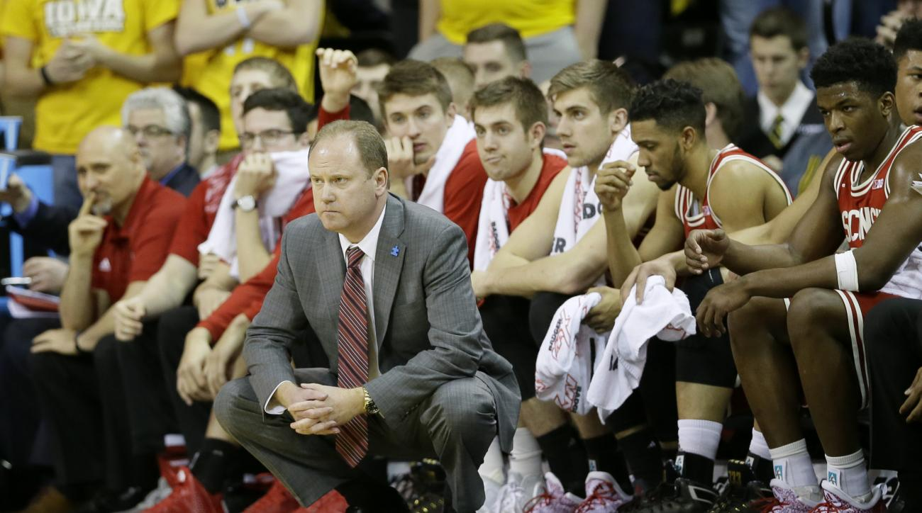 Wisconsin head coach Greg Gard looks on from the bench during the second half of an NCAA college basketball game against Iowa, Wednesday, Feb. 24, 2016, in Iowa City, Iowa. Wisconsin won 67-59. (AP Photo/Charlie Neibergall)