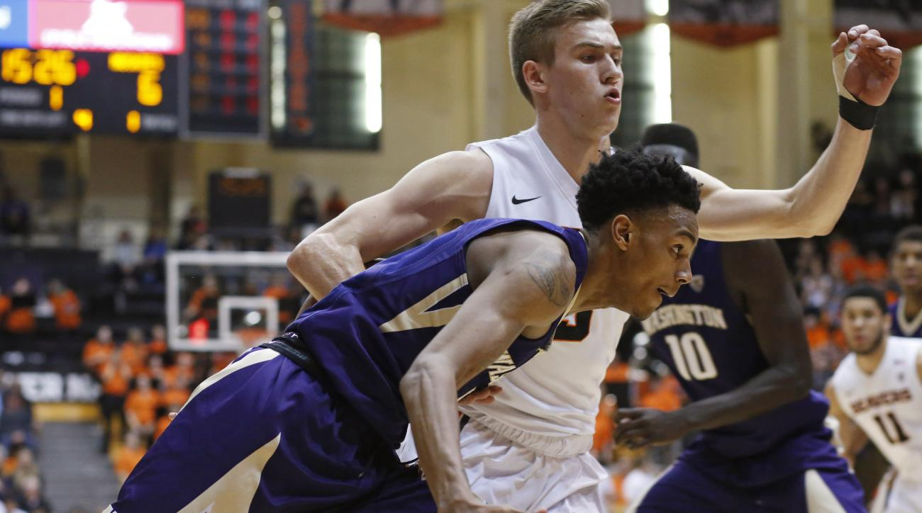 Washington's Dejounte Murray, front, tries to get to the basket while being guarded by Oregon State's Tres Tinkle during the first half of an NCAA college basketball game in Corvallis, Ore., on Wednesday, Feb. 24, 2016. (AP Photo/Timothy J. Gonzalez)