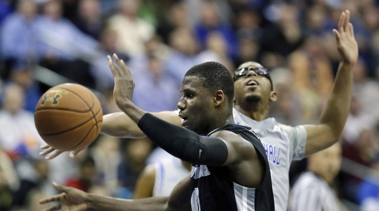 Providence forward Ben Bentil, left, loses the ball as he collides with Seton Hall forward Rashed Anthony, right, during the first half of an NCAA college basketball game Thursday, Feb. 25, 2016, in Newark, N.J. (AP Photo/Mel Evans)