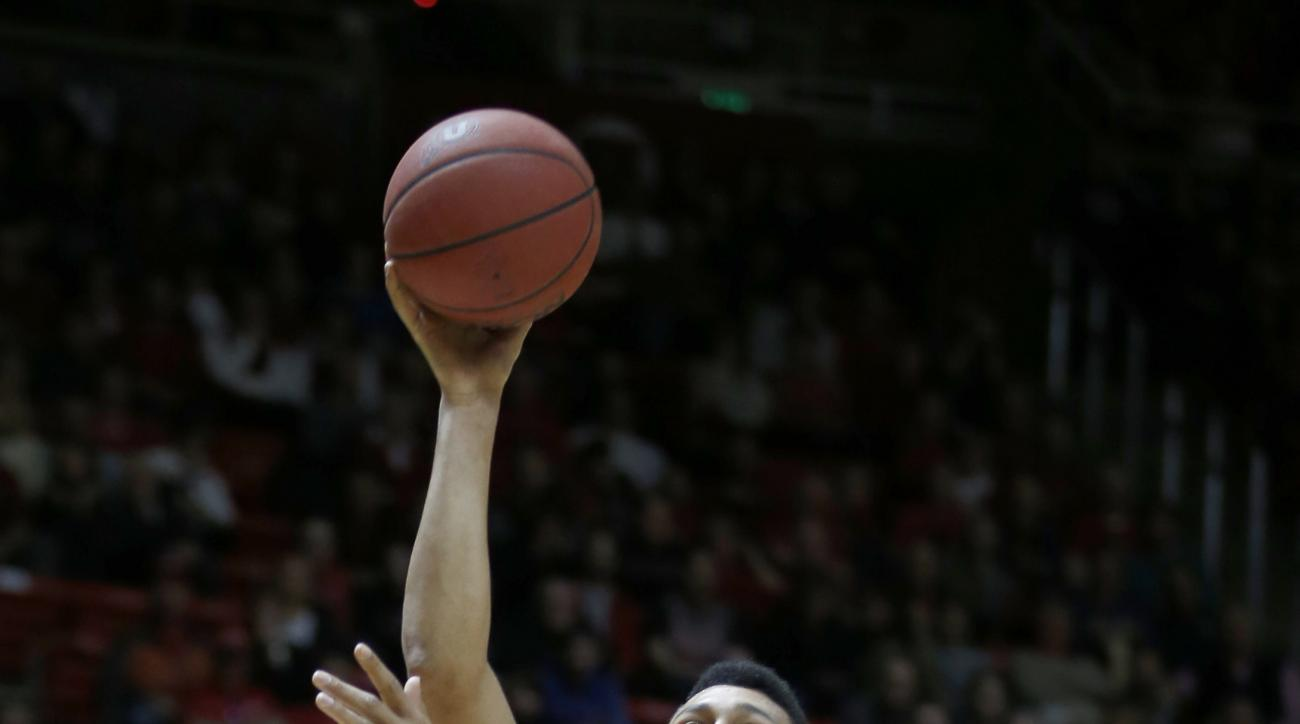 Utah forward Jordan Loveridge (21) shoots over Arizona State guard Tra Holder (0) during the first half of an NCAA college basketball game in Salt Lake City, Thursday, Feb. 25, 2016. (AP Photo/George Frey)