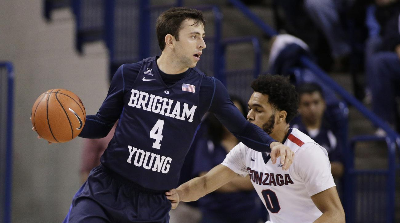 FILE - In this Jan. 14, 2016, file photo, BYU's Nick Emery (4) dribbles against Gonzaga's Silas Melson (0) during the first half of an NCAA college basketball game in Spokane, Wash. At BYU, Emery overcome early-season struggles that included getting a one