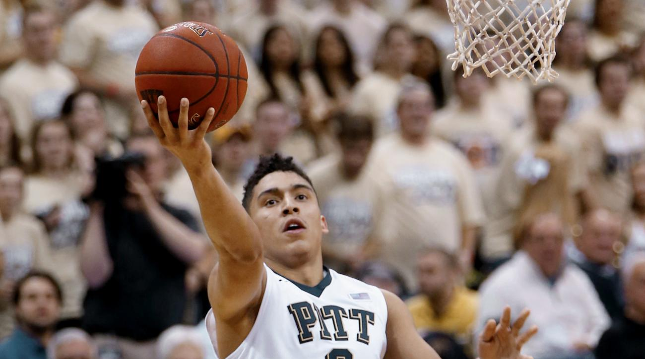 FILE--In this file photo from Jan. 6, 2016, Pittsburgh's James Robinson scores against Georgia Tech in an NCAA college basketball game in Pittsburgh. Robinson will make his school-record 130th start for Pitt on Sunday when the Panthers host No. 18 Duke. R
