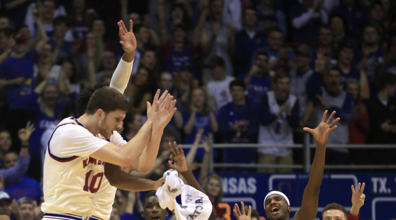Kansas players celebrate at the end of the first half of an NCAA college basketball game against Texas Tech in Lawrence, Kan., Saturday, Feb. 27, 2016. (AP Photo/Orlin Wagner)